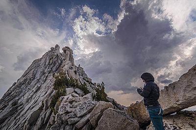 Climber resting on peak, Tuolumne Meadows, Yosemite National Park, California, United States - p924m2074912 by Alex Eggermont