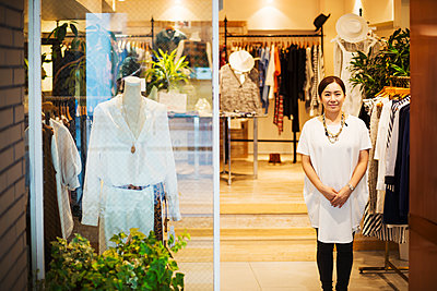 Woman working in a fashion boutique in Tokyo, Japan. - p1100m1185827 by Mint Images
