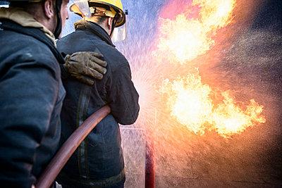 Firefighters in simulation training - p429m768898f by Monty Rakusen