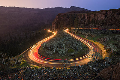 High angle view of vehicles moving on Rowena Crest - p1166m1486103 by Cavan Images