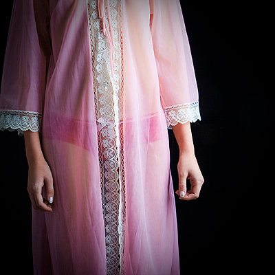 Woman in pink nightgown - p4130739 by Tuomas Marttila