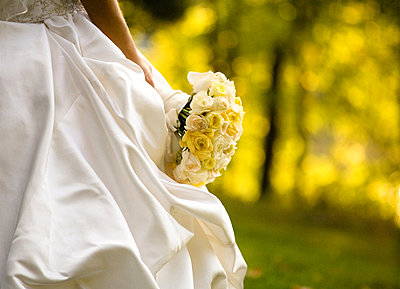 Bride with Bouquet Outdoors  - p6941888 by Maria K