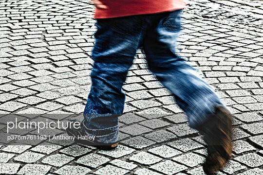Childs legs walking - p378m761193 by Anthony Hatley