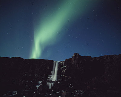 Northern Lights of Aurora Borealis behind a waterfall, Oxararfoss Waterfall, Thingvellir, Arnessysla, Iceland - p3483812 by Snaevarr Gudmundsson