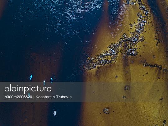 Aerial view of surfers in Teriberka River - p300m2206820 by Konstantin Trubavin
