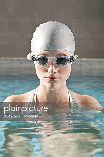 Woman in indoor swimming pool - p6420287 by brophoto