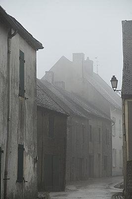 Village in rain - p1312m1502228 by Axel Killian