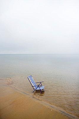 A sun chair at the waters edge Ängelholm Skåne Sweden. - p31217904f by Plattform