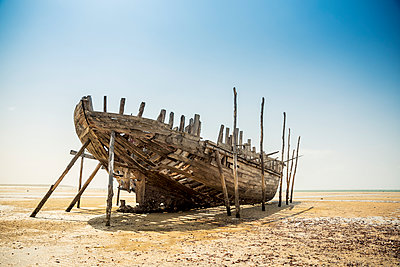 Wrecked fishing boat on Vilanculos beach, Bazaruto Archipelago; Mozambique - p442m1224981 by Dosfotos