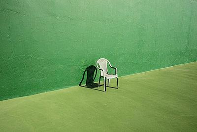 Chair on tennis courd - p1082m1538990 by Daniel Allan