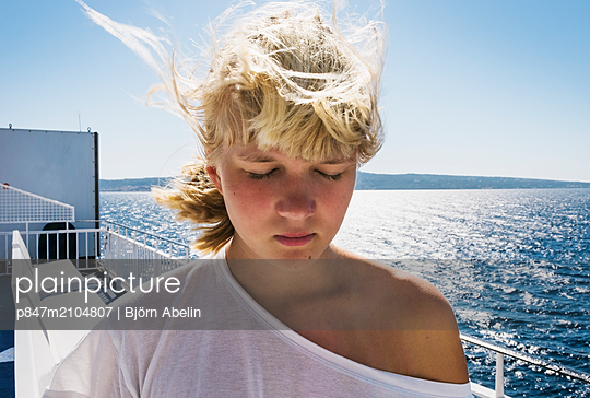 Teenage Girl With Closed Eyes On Boat Deck   - p847m2104807 by Björn Abelin