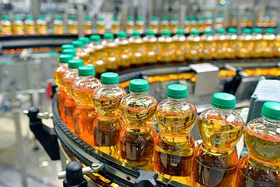 Apple-juice factory, bottling, apple juice - p300m2144053 by lyzs