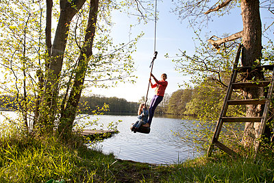 Swing at the lake - p781m944390 by Angela Franke