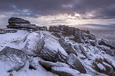 Snow covered granite rocks at Great Mis Tor in winter, Dartmoor National Park, Devon, England, United Kingdom, Europe - p871m1017479 by Adam Burton