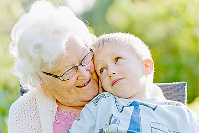 Grandmother with grandson sitting on lap - p312m1551873 by Johner Images