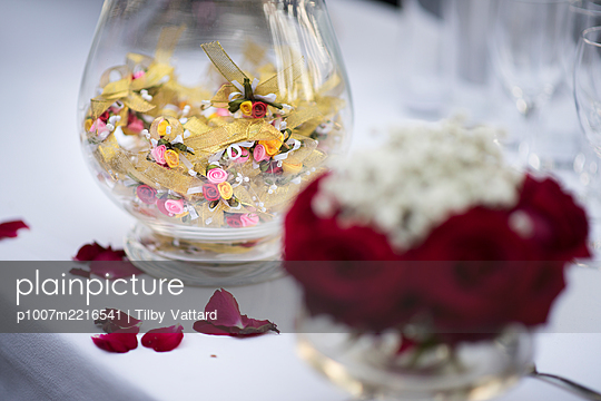 Glass jar full of wishes on wedding ceremony - p1007m2216541 by Tilby Vattard