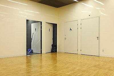Toilet doors ajar - p1048m1080108 by Mark Wagner