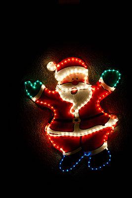 Illuminated santa claus - p429m929387f by Adie Bush