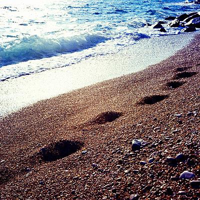 Footprints on the beach - p7780039 by Denis Dalmasso