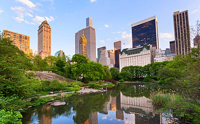 Skyline in reflection lake in Central Park, New York, USA - p429m1095530f by Henglein and Steets