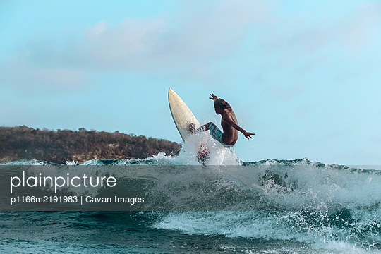 Surfer on a wave, Lombok, Indonesia - p1166m2191983 by Cavan Images