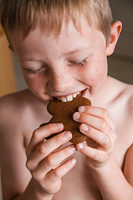Child Joyfully Eating Cookie - p1262m1083722 by Maryanne Gobble