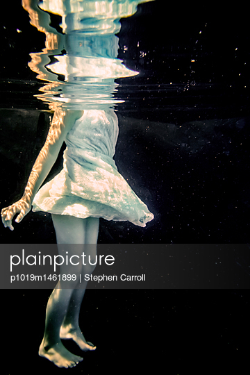Child floating underwater - p1019m1461899 by Stephen Carroll