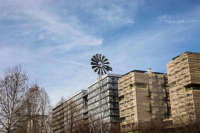 Windmill in town - p445m1552784 by Marie Docher