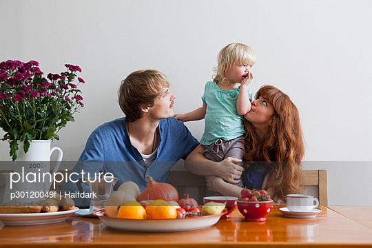 A young family having breakfast