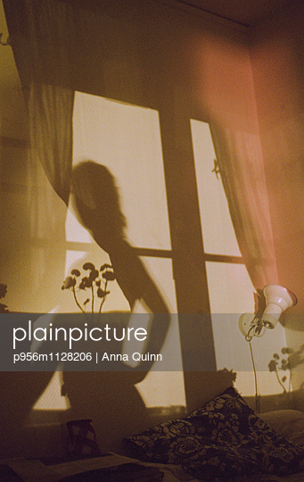 Shadow of a young woman - p956m1128206 by Anna Quinn
