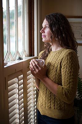 Woman drinking tea - p920m989904 by Jude Mooney