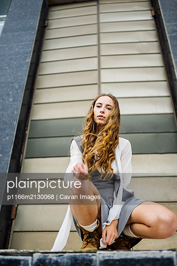 woman sitting near the gate - p1166m2130068 by Cavan Images