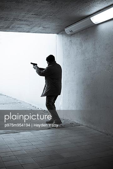 Man with Gun - p975m954194 by Hayden Verry