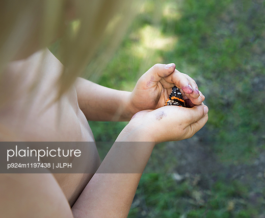 Boy holding insect