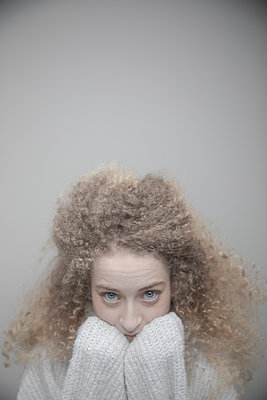 Portrait confident beautiful young woman with curly blonde hair - p1192m2066206 by Hero Images