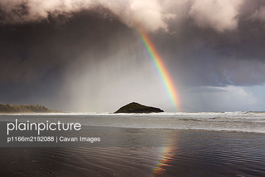 A rainbow appears over Long Beach near Tofino - p1166m2192088 by Cavan Images