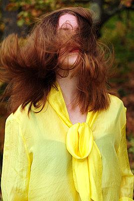 Teenage girl wearing yellow blouse - p1412m2128858 by Svetlana Shemeleva