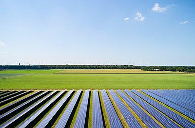 Large solar farms, Andijk, Noord-Holland, Netherlands - p429m2145806 by Mischa Keijser