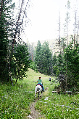 Horseriding in the mountains - p956m1092769 by Anna Quinn