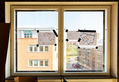 Blueprints on window - p312m1187659 by Susanne Kronholm