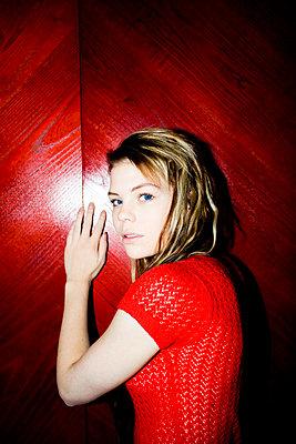 Woman wearing red dress - p4130510 by Tuomas Marttila