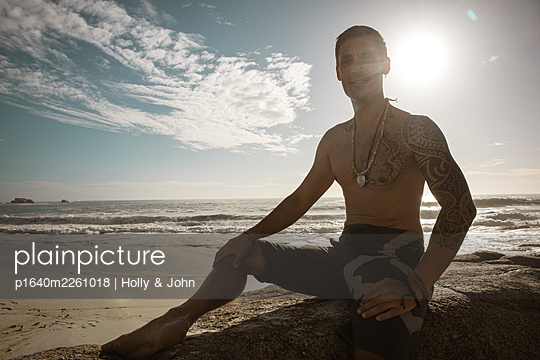 Bare-chested man on the beach at sunset - p1640m2261018 by Holly & John
