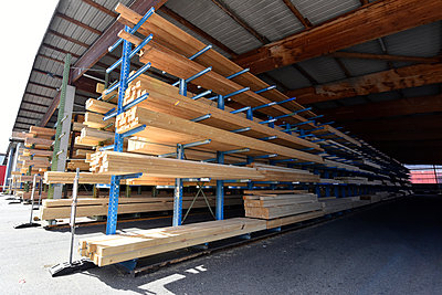 Planks stored on warehouse rack - p300m2221110 by lyzs