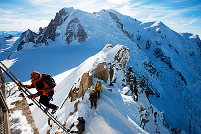 French Alps, climbers on Cosmique arete below the summit of Mont Blanc - p652m861500 by Christian Kober