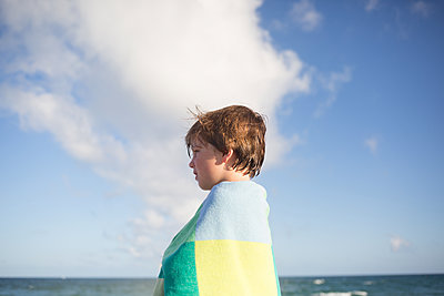Boy at the beach - p1308m2065297 by felice douglas