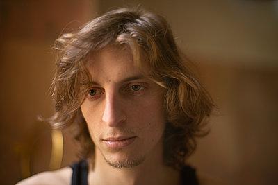 Sad young man - p1321m2087839 by Gordon Spooner