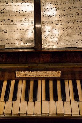 Old piano with sheets of music - p1170m1111617 by Bjanka Kadic