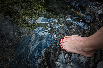 Feet on a stone by the river - p1007m1134064 by Tilby Vattard