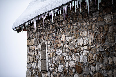 France, Icicles under a roof of a chapel  - p1007m2216550 by Tilby Vattard