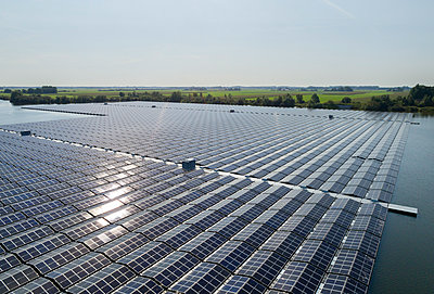 Solar park in the sunshine, Netherlands - p1132m2215538 by Mischa Keijser